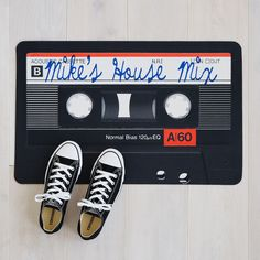 Welcome guests with a personalized mixtape and this custom doormat, featuring your family name. | $38
