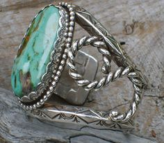 Native American Turquoise Bracelets,American Indian Silver Bracelets,NavajoCuff Bracelets,Zuni link bracelets,Sterling Silver Bangle Bracelets,AuthenticTurquoise Jewelry and Tibetan gemstone bracelets offered by The Turquoise Mine.com