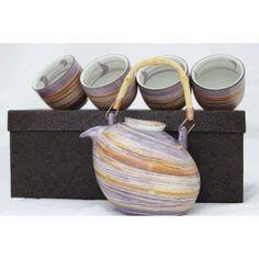 Set ceai Violet  Set ceainic cu capac si patru cesti pentru ceai. Setul include sita de inox. Capacitate ceainic: 400 ml                         Capacitate ceasca: 80 ml