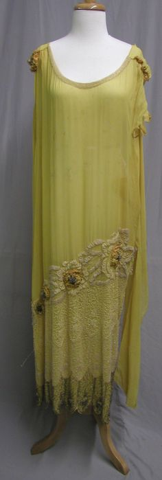 1920's Yellow Silk Beaded Chiffon Evening Gown. It was created in the twenties with yellow silk, then heavily beaded with a floral motif and crystal bugle beads. Front/ style that alices mother, alexandra, wears all the time