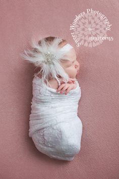 newborn baby girl in mothers wedding hair piece fredericksburg va newborn photographer
