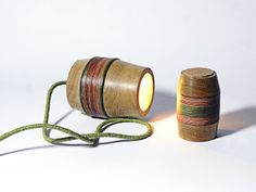 Lighting by Máire Condron made from turned wood and cork.