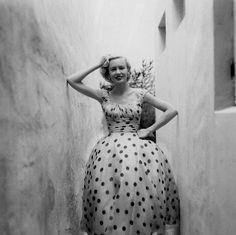 1954  Mrs Jessica Daves, Vogue editor is wearing a polda dot organdy dress. Richard Rutledge