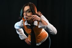 Young Woman holding Magnifying Glass