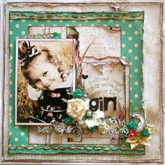 Another Nic Howard layout. Love the way she uses so many different types & sizes of flowers on one page.