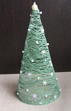 CHRISTMAS: DIY Christmas tree: cover cone with saran wrap, wrap with yarn, slather with Elmer's glue, dry, take away cone. Cone Christmas Trees, Winter Christmas, Christmas Holidays, Christmas Decorations, Christmas Ornaments, Xmas Tree, Ball Decorations, Christmas Lights, Cone Trees