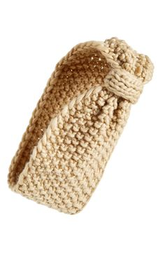This knotted head wrap in a chunky and oh-so-soft knit is cozy and comes in a variety of colors.