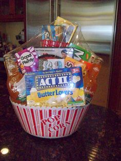 Movie night raffle basket round popcorn bucket variation. You can get this all @ Target (Grab a couple $5-10 DVDs!)