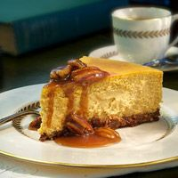 Love the idea of the bourbon sauce drizzled on this pumpkin cheesecake -