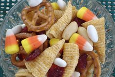 Fall Harvest Party Mix - The Fall Harvest Party Mix is a fun take on the traditional party mix. By adding candy corn to the mix, you instantly create a tasty treat fun for all ages. A super simply easy Halloween recipe for classroom or kids' parties!