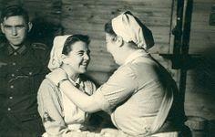 Two German Red Cross (DRK) Nurses Greet Each Other