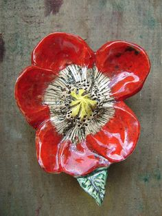 ceramic poppy - wish I could fill a wall with these