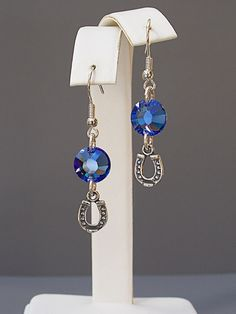 These sterling silver horseshoe earrings with sapphire blue Swarovski crystals are adorable!  The perfect gift for horse lovers and riders.  Designed and handmade by Joann Hayssen Design.