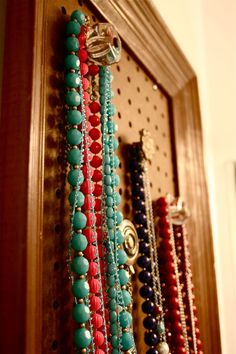 Peg-board and drawer pull necklace/bracelet organizer