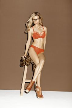 Spring|Summer 2013 - Society Orange Bras from € 79.95 Bottoms from € 37.95 Corset € 129.95