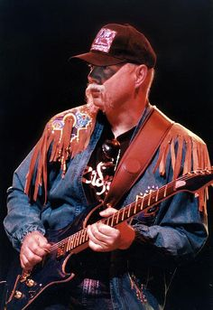 Kerry Livgren playing guitar.  Was also the writer of virtually every good Kansas song now recording/touring with the band Proto-Kaw.   VERY good music.