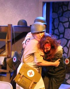 """production still of """"Cry Havoc"""" at Bakersfield Community Theatre. Angela Poncetta as Susan West and Julie Gaines as Doc Marsh"""