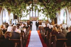 strung evergreens & lights at ceremony