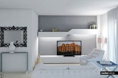 Sala #TV con #parete attrezzata, #divano #Maestro e poltrona #Soho in #pelle bianca.