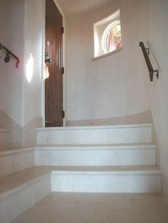 Vratza Limestone tiles - EUro Beige, on staircase. They are very good for lobby, as they bring the light in the room they are installed.
