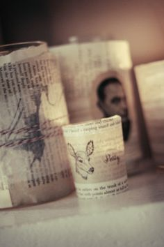 Old Book pages befriend jars you are about to throw away & with a little modge podge... style is created!