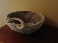 Lariat Rope Bowl-Perfect for western decor! A used lariat rope and pen-style soldering iron creates this versatile bowl.  Just melting the rope together as you layer the rope and shape it into a bowl.  I have made tall thinner bowls (that serve better as vases) and more open bowls (like this one).  I made this one for dried potpourri.