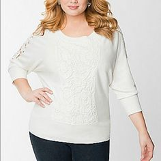 White Lane Braynt sweater with crochet details Our curve-flattering kabuki sweater is the must-own silhouette of the season, and we gave it a feminine update with a charming lace front. This terrific twist on the classic pullover highlights curves in all the right places with a scoop neckline and voluminous top that tapers to a fitted, ribbed hem. Sheer lace insets on 3/4 sleeves finish the look with an alluring glimpse of skin.    82 Viscose/18 Nylon Hand washable inside out Lane Bryant…