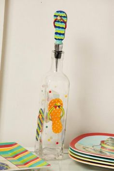 """Sandy Days Oil Bottle w/ Resin Stopper by Evergreen Enterprises, Inc. $14.99. 16 oz.. Includes sculpted stopper & standard pourer top. Great for yourself or as a unique gift idea. Original design by © Sandy Clough. 10.5""""H. Oil should be drizzled from a bottle that fits the mood of the moment, and this one accomplishes that feat with style. Days spent playing in the sand, kicking off your flip flops, and collecting seashells are treasured on this bottle. Fun and unexpected, t..."""