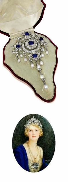 THE PORTLAND ANTIQUE SAPPHIRE, DIAMOND, AND NATURAL PEARL STOMACHER BROOCH. The rectangular-shaped sapphire within old-cut diamond surround to the four sapphire and diamond foliate clusters with ribbon surmount, suspending a series of natural pearl pendent drops with a detachable triple pearl drop to the center, mounted in silver and gold, circa 1880 via Christies