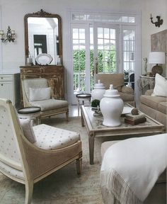 LOVE the french slipper chairs in the left side of this photo.