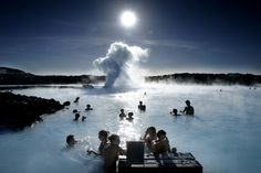 Blue Lagoon outside of Reykjavík, Iceland. 1.6 million gallons of approximately 100-degree seawater -- steam rises from these sky-blue hot springs across a surreal landscape of black lava mounds, and bathers slather themselves with silica mud, precipitated from the springwater.