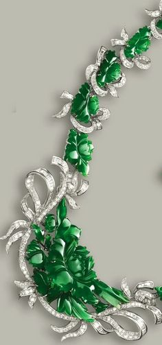 JADEITE AND DIAMOND NECKLACE The necklace composed of floral motifs, set with numerous carved jadeite plaques of translucent rich emerald green colour, decorated with brilliant-cut diamonds, length approximately 390mm, detachable brooch fitting.