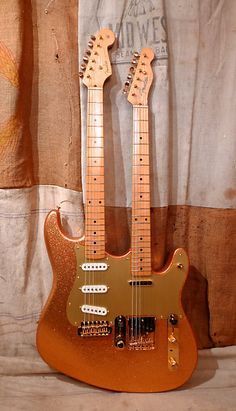 This Fender Doublecaster was made in the custom shop in 2002. It was custom ordered and the original order form is in the case. Stratocaster, telecaster, gold sparkle, '57 specs, gold anodized guard, gold hardware, stack knob, double whammy on the strat etc.. Master built by Art Esparza. This...