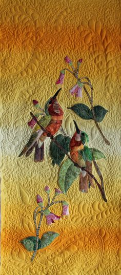 Stunning hummingbirds and background quilting.