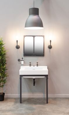 The Metro ceramic basin can be teamed with the Brunel stand, Brunel wall lights and accessories all from Aston Matthews