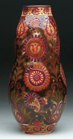 "ZSOLNAY DECORATED VASE. Zsolnay vase is highly decorated with stylized leaves and vines all against a deep green background. Signed on the bottom with a raised circle mark and impressed ""4233"" as well as a ""1"", ""36"" as well as ""48"". SIZE: 11-3/4 in. t.05/E870U"