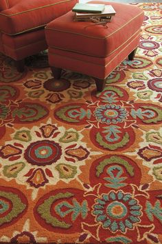 Like an enchanting kaleidoscope or magnificent #mosaic tile floor, the Tara #rug marries a #floral medallion pattern with vivid color and three-dimensional texture. The motifs are raised in a chunky hooked wool, while the cream background is hooked in a lower, tighter loop. In shades of orange, red and leaf green with pops of turquoise, this is a feast for the eyes.