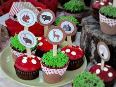 Party Tip: Display cupcakes at varying heights and use items like tree stumps or wooden platters to tie in the Woodland theme. This party was styled by Cupcake Wishes & Birthday Dreams. Printed party decor by Lily Bimble http://www.mygrafico.com/printables-templates/woodland-party/prod_7137.html Woodland party, Toadstool Cupcakes
