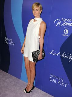 Vogue Daily — Stella McCartney dress, earrings, and bag, and Giuseppe Zanotti shoes