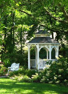 Such a lovely garden & gazebo. A place to enjoy nature & have some serenity. I love the look of a nice gazebo in a pretty garden.