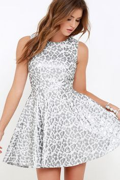 Make a grand and eye-catching entrance in the Louder than a Lion Silver Leopard Print Skater Dress! Ivory woven fabric boasts a shimmering silver leopard print across a tailored sleeveless bodice with darting and a fitted waist. A full skater skirt descends, offering a cocktail-ready shape. Hidden back zipper and clasp.