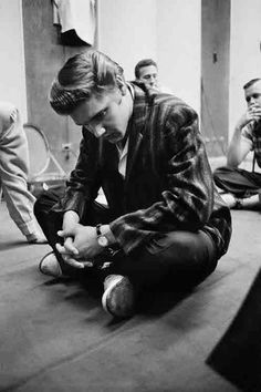 The Buddah  Elvis in deep concentration, sits on the floor of the recording studiolistening to a playback of his latesttake over a 14 inch high quality speaker. Everyone was focused on him to await his reaction. They then tried a few more takes RCA Victor Studio INew York City, July 2, 1956-