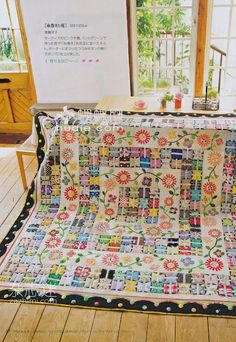 Butterfly quilt with appliqued flowers, Yokohama Quilt Show, published in Patchwork Quilt Tsushin.