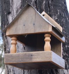 rustic bird feeder with turned posts