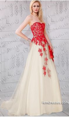 http://www.ikmdresses.com/ethereal-beaded-strapless-lace-applique-Tulle-ball-gown-p59747