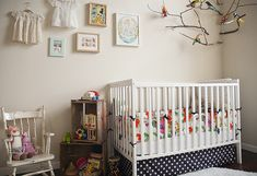 SUCH a sweet nursery - maybe a polka dotted crib skirt would be nice for Baby H?