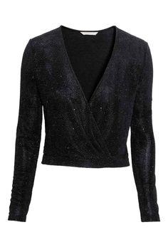 Camisola curta traçada : Camisola curta e de mangas compridas em jersey com estampado brilhante. Tem traçado com fecho de colchete na frente.