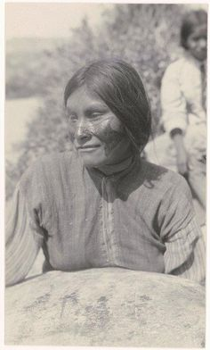 Seri woman with red face paint representing that she is pregnant - 1924