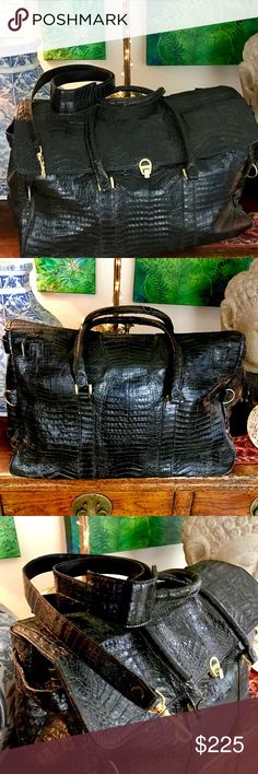 """Super ValueReal Alligator Weekender Bag This is a beautiful statement piece. Custom made black Alligator large weekender bag has gold hardware, two large interior pockets, detachable shoulder strap, is clean inside and out. Bottom has 4 gold grommet feet. Handles have some wear (see pic) and one gold grommet is missing under the bag flap which if I didn't tell you, you'd never know. In good condition and a Super Value! Cost $1200. Any questions please ask!!!  Size 22"""" x 18"""" x 8.5"""" Custom…"""