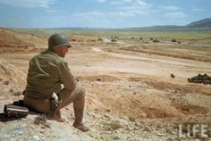 US General George S. Patton, wearing his trademark pearl handle pistols, watches the battle during the desert fighting between German and American forces in the El Guettar Valley. Location: El Guettar, Tunisia Date taken: 1943 Photographer: Eliot Elisofon North African Campaign, George Patton, Afrika Korps, Life Pictures, Color Pictures, German Army, World History, History Pics, Ww2 History